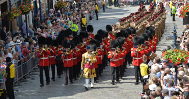 The Band of the Grenadier Guards lead an Armed Forces Day Parade through Guildford on Armed Forces Day 2015.