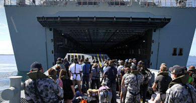 Ship's Company from NUSHIP Adelaide, play the part of civilian evacuees being transported to HMAS Canberra on a landing craft, during an evacuation exercise.