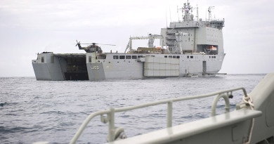A Landing craft approaches the well dock of HMAS CHOULES during operation Render Safe 14.