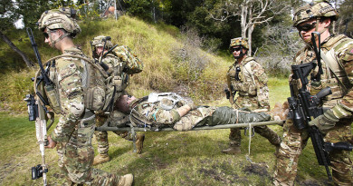Australian Army soldiers from Force Protection Element 4 simulate evacuating a casualty during a mission rehearsal exercise.