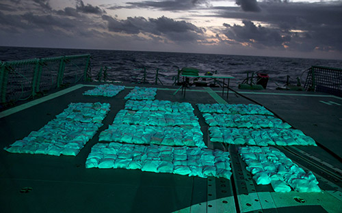 Narcotics from HMAS Newcastle's fifth seizure on the flight deck awaiting destruction.