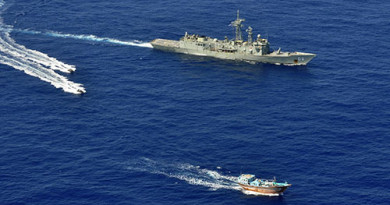 HMAS Newcastle's sea boats approach a dhow for a flag verification as part of operations involving narcotics interdiction off the east coast of Africa.