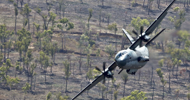 A No 35 Squadron C-27J Spartan flies at low level over Aussie bush.