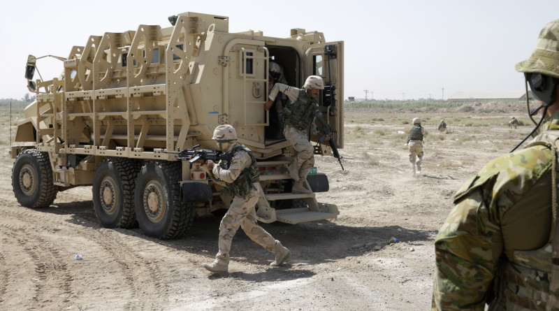 """Australian Army trainer observes an Iraqi soldier dismount from their """"Mine Resistant Ambush Protected (MRAP)"""" vehicle during a training exercise at the Taji Military Complex northwest of Baghdad: http://images.defence.gov.au/20150616adf8487947_032.jpg"""