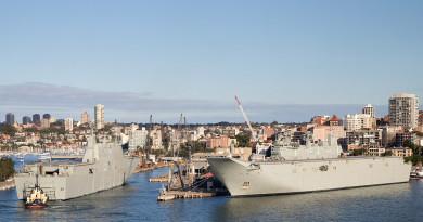The largest ships ever built for the Royal Australian Navy, Landing Helicopter Dock NUSHIP Adelaide, left, and HMAS Canberra at Fleet Base East, Garden Island, Sydney.