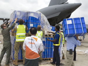 Royal Australian Air Force and World Vision staff work as a team to unload humanitarian supplies at Yangon Airport during Operation Myanmar Assist. Photo by Corporal Bill Solomou