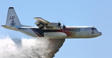'Thor', a C-130 Hercules contracted to the NSW Government to assist in fighting bushfires dispenses water during a demonstration over the Rickaby's drop zone near RAAF Base Richmond. Photo by Corporal David Said