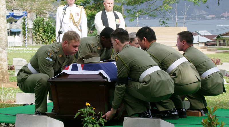 Soldiers from Australia's Federation Guard carry a coffin containing the remains of an unknown Australian soldier to his final resting place at the Commonwealth War Graves Cemetery in Ambon, Indonesia, on 10 September 2015. Photo by Commander Fenn Kemp