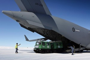 A Hägglunds snow vehicle is driven off a C-17A Globemaster at Wilkins Aerodrome, Antarctica.