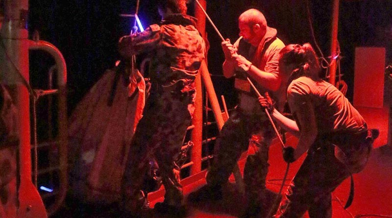 HMAS Melbourne Ship's Company load onboard an illegal cargo of narcotics. HMAS Melbourne intercepted the fishing vessel in the Indian Ocean and a subsequent search of the vessel revealed over 118 kilograms of high-grade heroin valued at AUD$108.8 million. Photo by Able Seaman Bonny Gassner