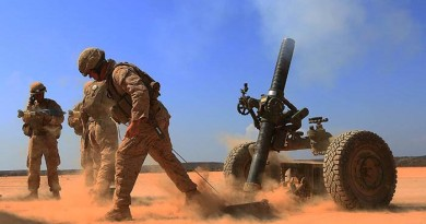 Marines with Alpha Battery, 1st Battalion 4th Marines, 13th Marine Expeditionary Unit fires a 120mm Rifled Tower Mortar. USMC photo by SSgt Matt Orr