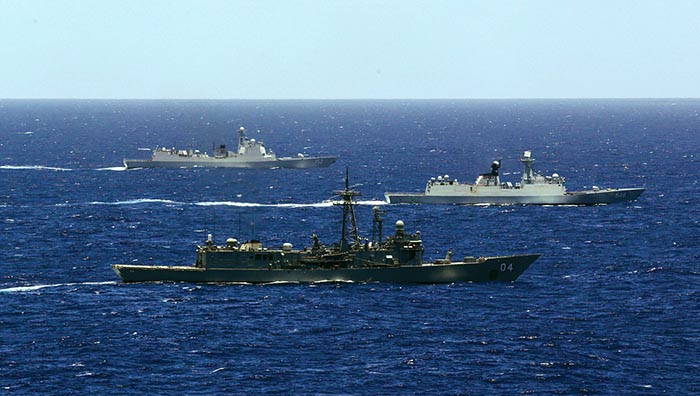 HMAS Darwin (front), PLA-N Yiyang and PLA-N Jinan transit through waters off the Brisbane coast. Photo by Able Seaman Sarah Ebsworth