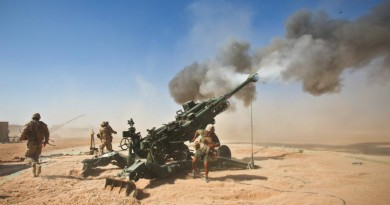 US Marines fire an M982 Excalibur round from an M777 155mm howitzer at Fire Base Fiddlers Green, Helmand province, Afghanistan, 1 October 2011. (Photo: US Department of Defense)(PRNewsFoto/Raytheon Company)