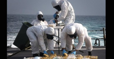 HMAS Melbourne personnel dispose of 65kg illegal narcotics (heroin) seized from a dhow in the northern Indian Ocean. Photo by Able Seaman Bonnie Gassner