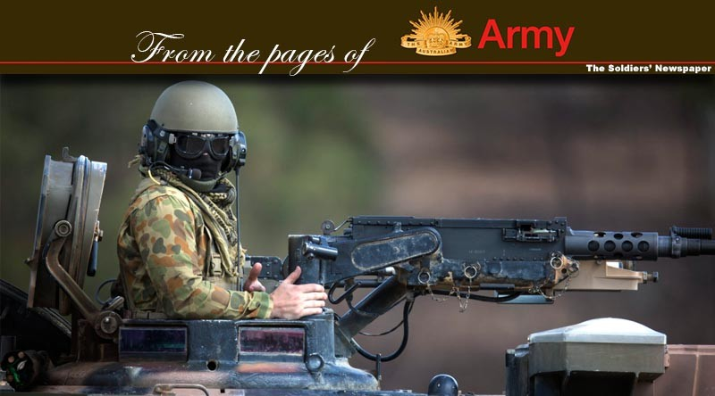 Australian Army soldier Lance Corporal Warren Cooper behind the 50cal machine gun of an M1A1 Abrams tank during Exercise Jericho Dawn held at Puckapunyal, Victoria. Photo by Corporal Oliver Carter.
