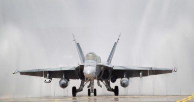 An F/A-18A Hornet goes through a desalination 'bird-bath'. Photo by Corporal Melina Young