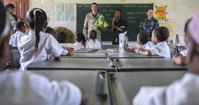 GLENO, Timor Leste (June 15, 2016) Cpl. Anatoliy Derepa, a member of the New Zealand Defense Force, and a native of Wellington, New Zealand, assigned to USNS Mercy (T-AH 19), educates local Timorese children at the Dona Ana Lemos Escuela elementary school on basic oral hygiene during a Pacific Partnership 2016 health outreach event. (U.S. Navy photo by Mass Communication Specialist 2nd Class William Cousins/Released)