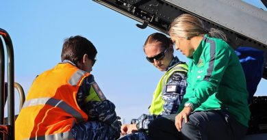 Leading Aircraftwoman Vanessa McNeil (left) and Leading Aircraftwoman Annie Tulloch show Katrina Gorry the cockpit of an F/A-18F Super Hornet during her visit to RAAF Base Amberley.