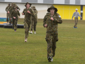 Australian Air Force Cadet Shannon Stephens running to the next obstacle during battle PT at the Australian Defence Force Academy. *** Local Caption *** Australian Air Force Cadets (AAFC) from No 2 Wing commemorated the 75th anniversary of the AAFCs with a tour of military establishments and museums/memorials in Williamtown, Canberra and Sydney. The Australian Air Force Cadets (AAFC) is a youth oriented organisation that is administered and actively supported by the Royal Australian Air Force. The AAFC teaches you valuable life skills and will help you develop qualities including leadership, self reliance, confidence, teamwork and communication. Their fundamental aim is to foster qualities that will enable cadets to become responsible young adults, who will make a valuable contribution to the community. Please note the following distinction: Australian Air Force Cadets (AAFC), along with Australian Navy Cadets and Australian Army Cadets are members of the Australian Defence Force (ADF) Cadets. ADF Cadets are participants in the youth development program conducted by the three services in cooperation with the community but they are not members of the ADF. Officer Cadets (Air Force) and Staff Cadets (Army) are trainee officers undertaking instruction at the Australian Defence Force Academy or the Air Force Officers' Training School or Royal Military College Duntroon, The terms 'ADF Cadets', 'Officer Cadets' and 'Staff Cadets' are not interchangeable. Trainee naval officers are not cadets; they are commissioned officers with the rank of Midshipman.