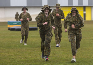 Australian Air Force Cadets Alleha Read and Monique Bolton run to the next obstacle during battle PT in the Canberra cold and rain at the Australian Defence Force Academy. *** Local Caption *** Australian Air Force Cadets (AAFC) from No 2 Wing commemorated the 75th anniversary of the AAFCs with a tour of military establishments and museums/memorials in Williamtown, Canberra and Sydney. The Australian Air Force Cadets (AAFC) is a youth oriented organisation that is administered and actively supported by the Royal Australian Air Force. The AAFC teaches you valuable life skills and will help you develop qualities including leadership, self reliance, confidence, teamwork and communication. Their fundamental aim is to foster qualities that will enable cadets to become responsible young adults, who will make a valuable contribution to the community. Please note the following distinction: Australian Air Force Cadets (AAFC), along with Australian Navy Cadets and Australian Army Cadets are members of the Australian Defence Force (ADF) Cadets. ADF Cadets are participants in the youth development program conducted by the three services in cooperation with the community but they are not members of the ADF. Officer Cadets (Air Force) and Staff Cadets (Army) are trainee officers undertaking instruction at the Australian Defence Force Academy or the Air Force Officers' Training School or Royal Military College Duntroon, The terms 'ADF Cadets', 'Officer Cadets' and 'Staff Cadets' are not interchangeable. Trainee naval officers are not cadets; they are commissioned officers with the rank of Midshipman.