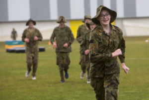 Australian Air Force Cadets Alleha Read running to the next obstacle during battle PT in the Canberra cold and rain at the Australian Defence Force Academy. *** Local Caption *** Australian Air Force Cadets (AAFC) from No 2 Wing commemorated the 75th anniversary of the AAFCs with a tour of military establishments and museums/memorials in Williamtown, Canberra and Sydney. The Australian Air Force Cadets (AAFC) is a youth oriented organisation that is administered and actively supported by the Royal Australian Air Force. The AAFC teaches you valuable life skills and will help you develop qualities including leadership, self reliance, confidence, teamwork and communication. Their fundamental aim is to foster qualities that will enable cadets to become responsible young adults, who will make a valuable contribution to the community. Please note the following distinction: Australian Air Force Cadets (AAFC), along with Australian Navy Cadets and Australian Army Cadets are members of the Australian Defence Force (ADF) Cadets. ADF Cadets are participants in the youth development program conducted by the three services in cooperation with the community but they are not members of the ADF. Officer Cadets (Air Force) and Staff Cadets (Army) are trainee officers undertaking instruction at the Australian Defence Force Academy or the Air Force Officers' Training School or Royal Military College Duntroon, The terms 'ADF Cadets', 'Officer Cadets' and 'Staff Cadets' are not interchangeable. Trainee naval officers are not cadets; they are commissioned officers with the rank of Midshipman.