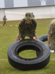 Australian Air Force Cadets Kyle Storeywood flipping a tyre during battle PT in the Canberra cold and rain at the Australian Defence Force Academy. *** Local Caption *** Australian Air Force Cadets (AAFC) from No 2 Wing commemorated the 75th anniversary of the AAFCs with a tour of military establishments and museums/memorials in Williamtown, Canberra and Sydney. The Australian Air Force Cadets (AAFC) is a youth oriented organisation that is administered and actively supported by the Royal Australian Air Force. The AAFC teaches you valuable life skills and will help you develop qualities including leadership, self reliance, confidence, teamwork and communication. Their fundamental aim is to foster qualities that will enable cadets to become responsible young adults, who will make a valuable contribution to the community. Please note the following distinction: Australian Air Force Cadets (AAFC), along with Australian Navy Cadets and Australian Army Cadets are members of the Australian Defence Force (ADF) Cadets. ADF Cadets are participants in the youth development program conducted by the three services in cooperation with the community but they are not members of the ADF. Officer Cadets (Air Force) and Staff Cadets (Army) are trainee officers undertaking instruction at the Australian Defence Force Academy or the Air Force Officers' Training School or Royal Military College Duntroon, The terms 'ADF Cadets', 'Officer Cadets' and 'Staff Cadets' are not interchangeable. Trainee naval officers are not cadets; they are commissioned officers with the rank of Midshipman.