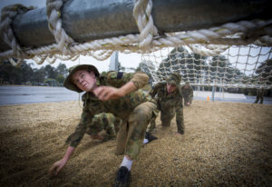 Australian Air Force Cadets Lachlan Bulmer tackles an obstacle during battle PT in the Canberra cold and rain at the Australian Defence Force Academy. *** Local Caption *** Australian Air Force Cadets (AAFC) from No 2 Wing commemorated the 75th anniversary of the AAFCs with a tour of military establishments and museums/memorials in Williamtown, Canberra and Sydney. The Australian Air Force Cadets (AAFC) is a youth oriented organisation that is administered and actively supported by the Royal Australian Air Force. The AAFC teaches you valuable life skills and will help you develop qualities including leadership, self reliance, confidence, teamwork and communication. Their fundamental aim is to foster qualities that will enable cadets to become responsible young adults, who will make a valuable contribution to the community. Please note the following distinction: Australian Air Force Cadets (AAFC), along with Australian Navy Cadets and Australian Army Cadets are members of the Australian Defence Force (ADF) Cadets. ADF Cadets are participants in the youth development program conducted by the three services in cooperation with the community but they are not members of the ADF. Officer Cadets (Air Force) and Staff Cadets (Army) are trainee officers undertaking instruction at the Australian Defence Force Academy or the Air Force Officers' Training School or Royal Military College Duntroon, The terms 'ADF Cadets', 'Officer Cadets' and 'Staff Cadets' are not interchangeable. Trainee naval officers are not cadets; they are commissioned officers with the rank of Midshipman.