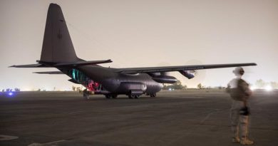 A New Zealand soldier provides force protection as a Royal New Zealand Air Force C-130 Hercules aircraft carrying New Zealand and Australian soldiers prepares to take off from the Taji military complex in Iraq. ADF photo
