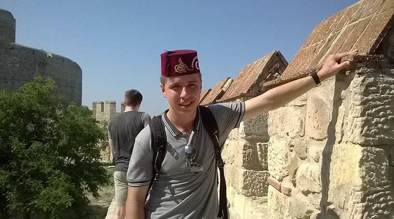Cadet Under Officer David Neilson with one of three Fez's brought home.