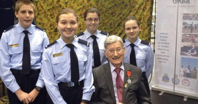 WWII Warrant Officer and Knight in the French Légion d'Honneur Doug Leak visits (left to right) Cadet Simon Russell (604 Squadron), Cadets Kelly and Emma Parkin (613 Squadron), and Cadet Samantha Stevens (609 Squadron) at the AAFC stand at the Royal Adelaide Show.