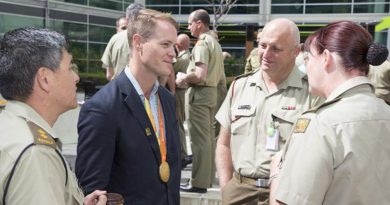 Australian Army soldier and 2016 Paralympic Games gold medallist Sapper Curtis McGrath chats to Army HQ staff during a morning tea at Russell Offices, Canberra, on 6 October 2016. Photo by Sergeant Mick Davis.