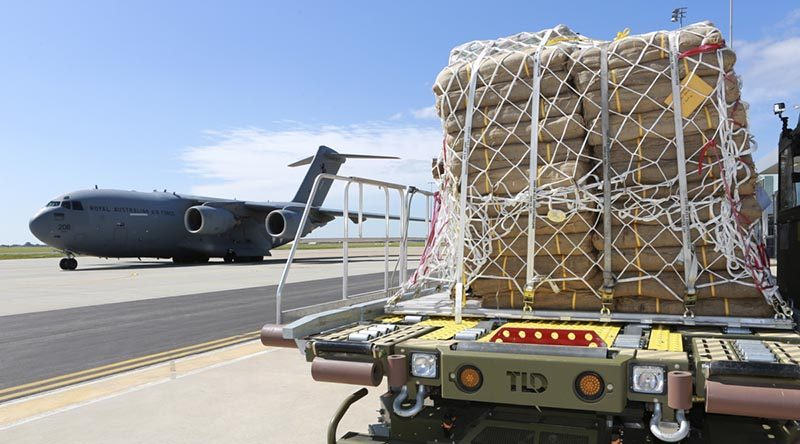 Pallets of sandbags arrive at RAAF Base Edinburgh delivered by a No 36 Squadron C-17A Globemaster. Photo by Corporal Craig Barrett.