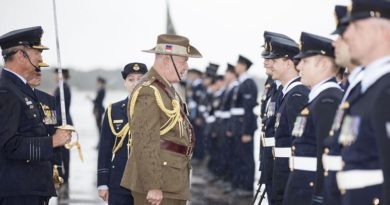 Governor-General Sir Peter Cosgrove talks to a RAAF member during a parade to mark the Centenary of Numbers 1, 2, 3 and 4 Squadrons. Photo by Corporal Nicci Freeman.