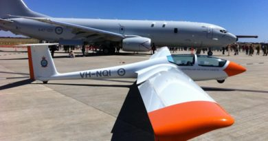 One of 6 Wing's gliders, the ASK-21 Mi, sits on the tarmac at RAAF Edinburgh beside Australia's new Maritime Patrol Aircraft – the P-8A Poseidon