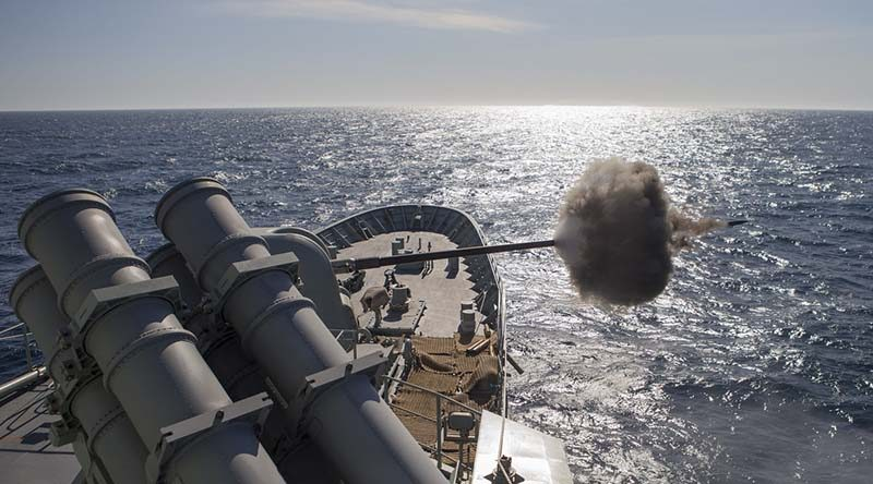 HMAS Arunta fires her 5-inch gun against a simulated fast boat attack during the Fleet Concentration Period 2015. Photo by Leading Seaman Bradley Darvill.