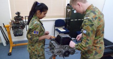 Leading Cadet Jay Dolphin from 619 ('City of Onkaparinga') Squadron at Seaford, and Cadet Shivani Patel from 601 Squadron at Keswick Barracks get a 'hands-on' insight into an aircraft engine.