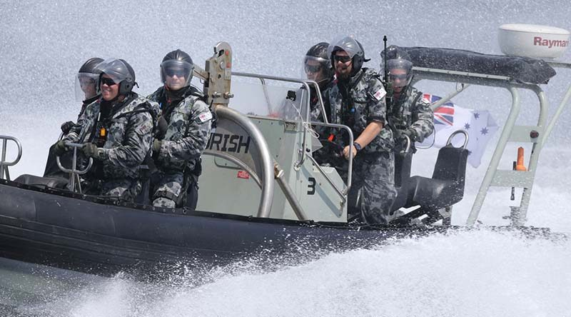 HMAS Perth's boarding party smash through rough seas to close with a vessel of interest in the Middle East Region. Photo by Able Seaman Richard Cordell.