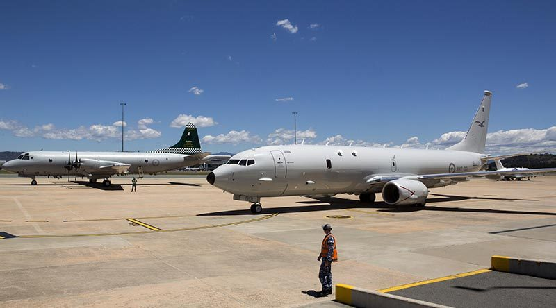 Australia's first P-8A Poseidon aircraft at Defence Establishment Fairbairn parked next to an 11 Squadron P-3 Orion, the aircraft it will replace. Photo by Flight Sergeant Kev Berriman.