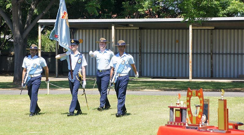 Banner Bearer Cadet Under Officer Hayden Skiparis, with Banner Warrant Officer Cadet Sergeant Joshua Watson and Banner Escorts Cadet Corporal Suyash Jain and Cadet Corporal Michael Santos proudly march on the Banner of No 6 Wing AAFC. Photo by Pilot Officer (AAFC) Paul Rosenzweig.