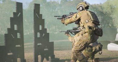 Corporal James Cunningham and Corporal Karl Fabreschi (kneeling) clear the range of 'enemy' activity during the combat shooting skills training activity at Majura training area outside Canberra. Photo by Corporal Nunu Campos.