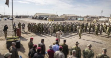 Commander Task Group Taji Colonel Andrew Lowe salutes Deputy Commander Training - Combined Joint Forces Land Component Command, Operation Inherent Resolve, Brigadier General Francesco Ceravolo at the Task Group Taji 3/4 transfer of authority parade at the Taji Military Complex in Iraq. Photo by Leading Seaman Jake Badior.