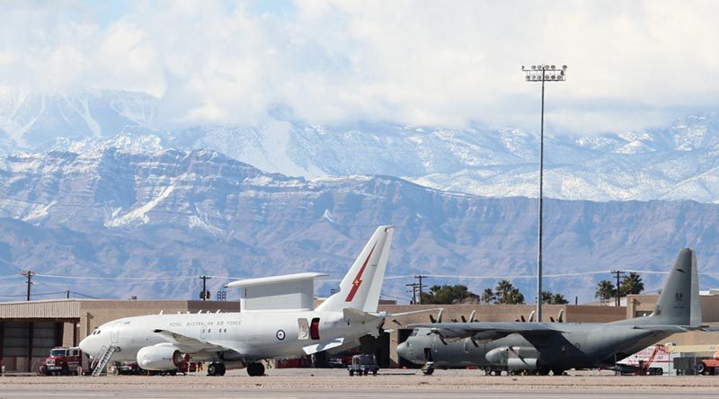 A Royal Australian Air Force E-7A Wedgetail and C-130J Hercules on the flightline at Nellis Air Force Base. Photo by Eamon Hamilton.