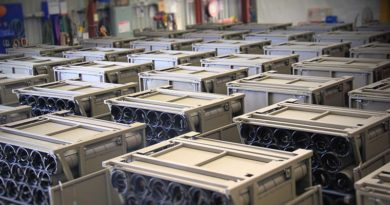Australian Army unit load ammunition containers in a warehouse ready for delivery to artillery soldiers for the safe transport and storage of 155mm ammunition in the field.