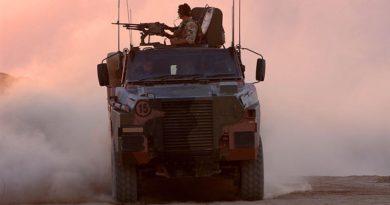 Australian soldiers on patrol in Afghanistan aboard a Bushmaster. Photo by Corporal Bernard Pearson.