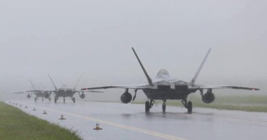 F-22s arrive at RAAF Base Tindal during a monsoonal downpour. Photo by Sergeant Andrew Eddie.