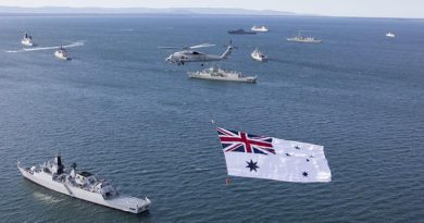 The Australian White Ensign flies over a multi-national fleet of ships at anchor in Jervis Bay. File photo by Able Seaman Sarah Williams.