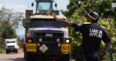 A Queensland Police officer directs an Army Mack Truck From 3 Combat Engineering Regiment as it arrives in Bowen, Queensland, in the wake of Tropical Cyclone Debbie. Photo by Corporal David Said.
