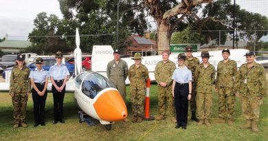 The AAFC ASK-21 Mi glider with cadets from No 602 Squadron at Woodside, SA (left to right): CDT Grace Wilton, LCDT Anita Gardner, CCPL Benjamin Grillett, LCDT Ben Carter, CCPL Erika Gardner, CCPL Blake Harding, CDT Bianca Willsmore, LCDT Aiden Carling, CDT Lachlan Willsmore, CDT Kyle Bratkovic and CCPL Olivia Gardner. Leading Cadet Ben Carter (in Flying Dress) qualified for his Solo Gliding Badge in 2014.