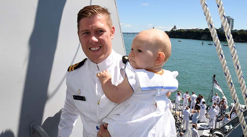 Lieutenant Brock West and his daughter Aria on HMNZS Taupo at Devonport Naval Base.