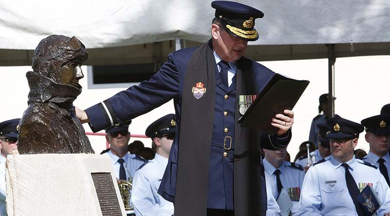 Air Force Director-General Chaplaincy, Air Commodore Kevin Russell, blesses Air Marshal Sir George Jones' memorial during the Rushworth RSL's Centenary of Anzac Commemoration Ceremony. Photo by Corporal Colin Dadd.